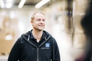 Dan Espen Kvale with warehouse in background